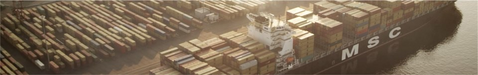 Aerial image of shipping crates on barge.