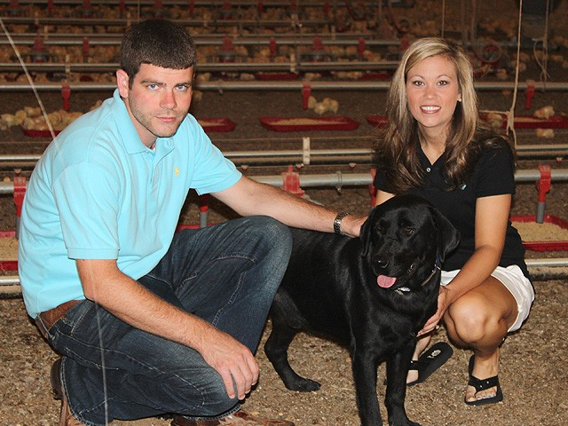 Triple G Farm owners and their dog