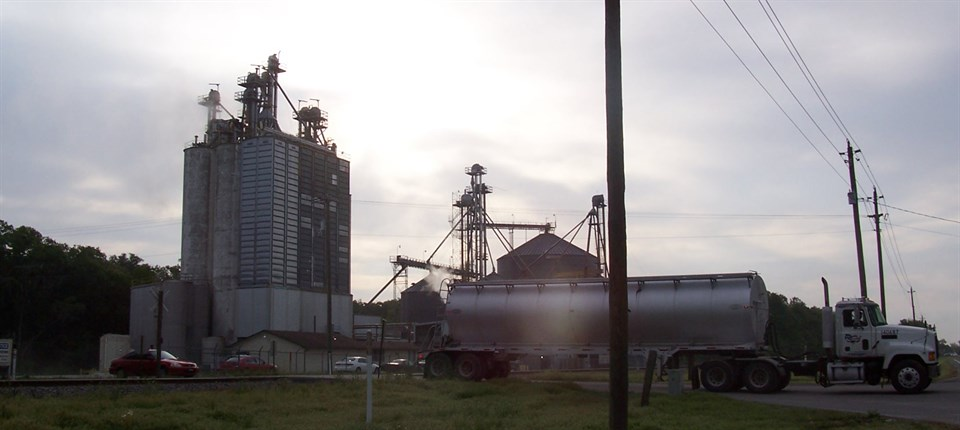 Large truck pulling away from feedmill